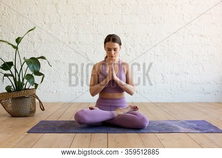 Young Attractive Sporty Woman Practicing Yoga, Doing Ardha Padmasana Exercise, Meditating In Half Lo