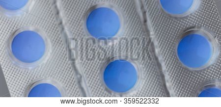 Blister With Blue Pills, Macro Photo, Inversion.