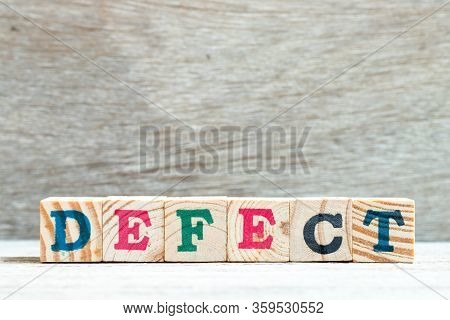 Letter Block In Word Defect On Wood Background