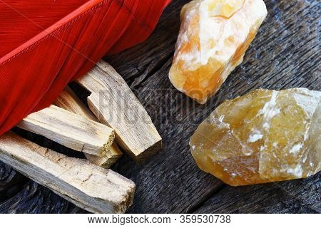 A Close Up Image Of Palo Santo Smudge Sticks And Citrine Crystals Used In Energy Clearing And Healin