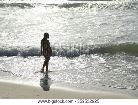 Rio De Janeiro, Brasil- March 05, 2020: Citizen Swim And Sunbathe On The Beach Of Copacabana