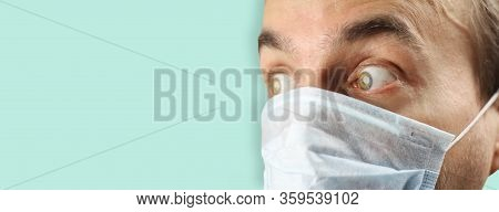 Closeup Man Frightened Face With Medical Mask, Patient Looks Sideways With Fright And Panic, Virus O