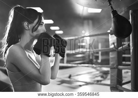 Close Up Of Fit Brunette Woman Wearing Boxing Gloves. Young Attractive Fighter With Perfect Make Up