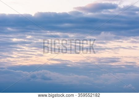 Bright Sky With Clouds And Glare From The Sun's Rays