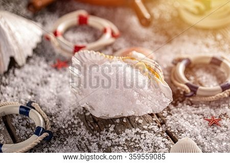 Luxurious Sea Salt Flakes In Seashell On Wooden Background