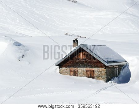 Cow Stable Sunk In The Deep Snow On The Alps Mountain In Winter