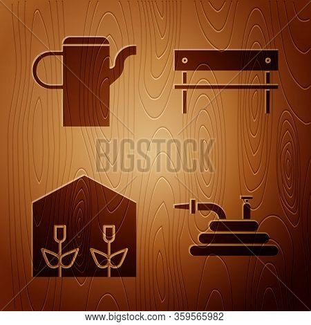 Set Garden Hose Or Fire Hose, Watering Can, Home Greenhouse And Plants And Bench On Wooden Backgroun