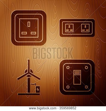 Set Electric Light Switch, Electrical Outlet, Wind Turbine And Electrical Outlet On Wooden Backgroun