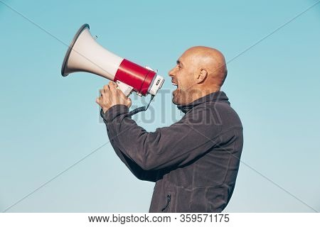 Cheerful Man Shouting, Screaming Through A Megaphone, Announcing Something News, Announcments Concep