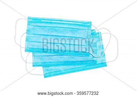 Three Blue Medical Facial Masks Isolated On A White Background. Medical Care Concept