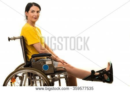 Woman In Wheelchair With Feet Orthosis Isolated On White Background