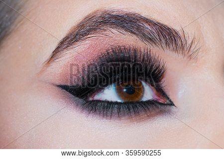 Beautiful Macro Shot Of Female Eye With Extreme Long Eyelashes And Smoky Makeup. Closeup Macro Shot