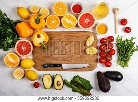 Board With Healthy Products For Immunity Boosting Or Diet Food Top View. Vegetables And Fruits To Bo
