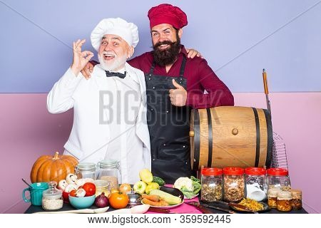 Professional Chef Man Showing Sign For Delicious. Male Chef In White Uniform With Perfect Sign. Two