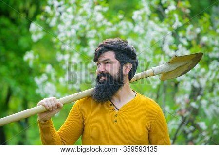 Farm. Gardener Work. Spring. Work In Garden. Farmer Working In Garden. Plants. Gardening. Bearded Ga