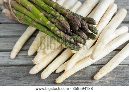 Green And White Asparagus On Rustic Gray Wooden Planks. Close-up Of Vegetables For A Healthy Nutriti