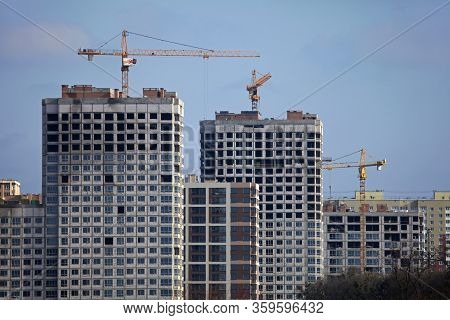 Kiev, Ukraine -  February 17, 2019: High-rise Construction Cranes And Array Of Buildings Under Const