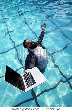 Funny And Crazy Man Freelancer In Suit Using A Computer In Swimming Pool. Funny Freelanc. Working On