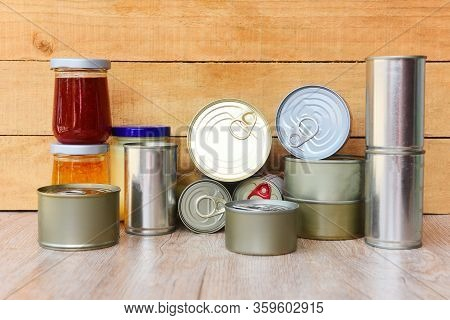 Various Canned Food In Metal Cans On Wooden Background / Canned Goods Non Perishable Food Storage Go