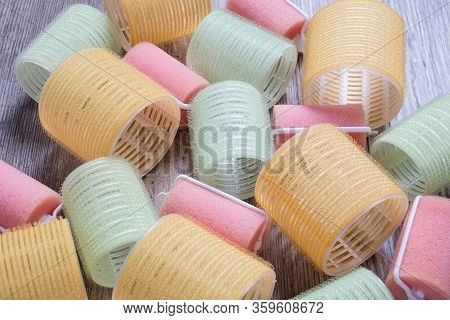 Velcro Curlers On A Wooden Background. Curl, Wave, Volume, Hair. Beauty, Fashion. Hairdresser. Styli