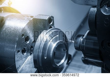 The Cnc Lathe Machine In Metal Working Process Forming Cutting The Metal Ring Shape Parts. The Hi Te