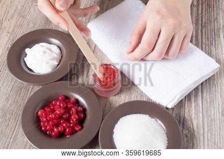 A Woman Makes A Natural Home Scrub. Skin Care. Natural Ingredients For Making A Scrub, Sugar, Cream,