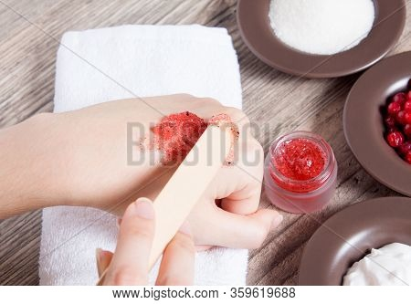 A Woman Applies A Natural Homemade Scrub With A Spatula. Skin Care. Natural Ingredients For Making A