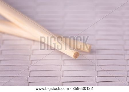 Two Wooden Chopsticks. Chopsticks Close Up. Chopsticks On The Table Surface.