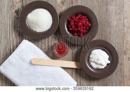 Ingredients For Making A Natural Homemade Scrub. Skin Care. Sugar, Cream, Berries, Salt. Moisturizin