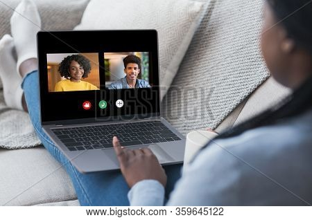 Group Video Chat. African American Woman Having Online Conference Call On Laptop With Friends, Commu