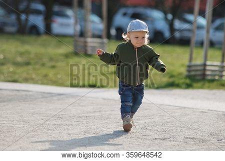 Child Girl Running In The Playground Close Up