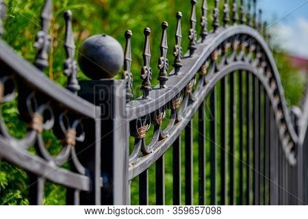 Image Of A Beautiful Decorative Metal Wrought-iron Fence With Artistic Forging. Metal Fence Close-up