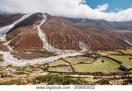 Picturesque View Of Moraines And Glaciers Melting Near Panboche Settlement 3985m Covered With Clouds