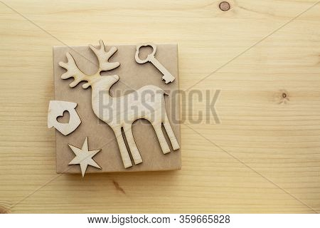 Cardboard Boxes On A Warm Wooden Background On The Left. Vintage Gift Box, Package With Wooden Toys