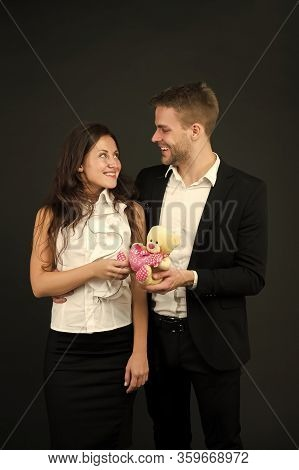 Flirting And Dating. Love And Romance. Gift With Love. Couple On Romantic Date. Formal Couple With T
