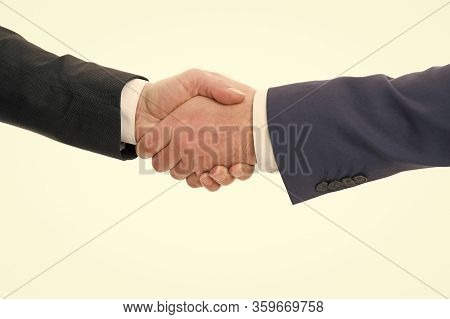 Handshake Deal. Handshake Isolated On White. Business Agreement. Contract Or Cooperation. Companions