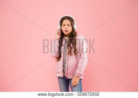 Full Enjoyment. Singing Along To Tune. Happy Child Enjoy Listening To Sound Track. Little Girl Wear