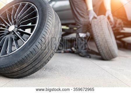 Car Wheel Repair Shop Outdoor Ground . Seasonal Winter Tyre Change At Workshop. Vehicle Tire Repair,