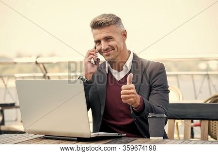 Technology As Business Necessity. Businessman Show Thumbs Up. Man Use Mobile And Computer Technology