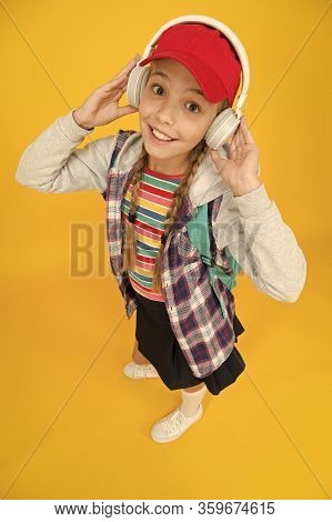 Cute Hipster Teenager Listening Music Headphones Yellow Background. Cool Schoolgirl. Teens Fashion.