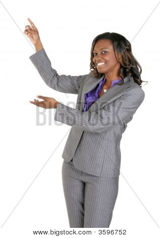 Sexy Businesswoman Gesturing Towards Copy Space.