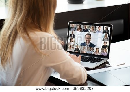 People Engaged In Group Videocall, Laptop Screen Webcam Application View