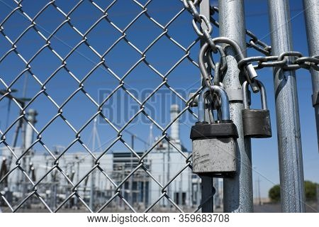 Gas Power Plant Behind Fence And Locked Gate