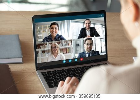 Computer Screen View Diverse Businesspeople Negotiating Distantly Using Videocall