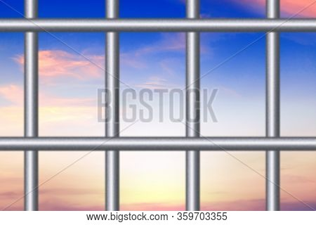 Freedom Concept. Metal Cage On Sunset Or Sunrise Background. Information Censorship.