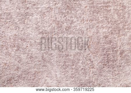 Light Beige Fluffy Background Of Soft, Fleecy Cloth. Texture Of Brown Textile Backdrop With Shiny Pa