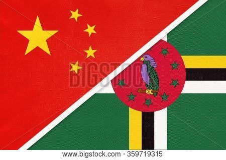 China Or Prc Vs Dominica National Flag From Textile. Relationship Between Asian And American Countri
