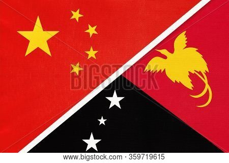 China Or Prc Vs Papua New Guinea National Flag From Textile. Relationship Between Asian And Oceania