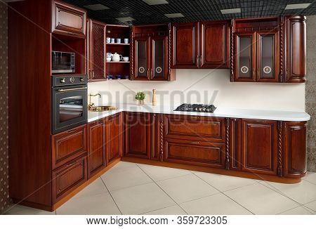 Interior Of Modern Kitchen In Classic Style With Golden Elements Cherry Alder Wood Cabinetry With Bu