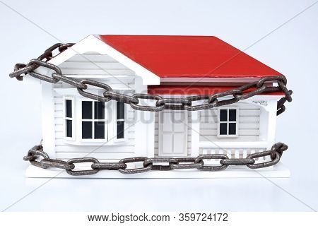 Home Security Or Safety Concept: Nz Or Australian Ville Style Timber House Model With Chains